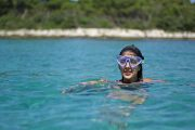 woman is snorkelling in a sand lagoon