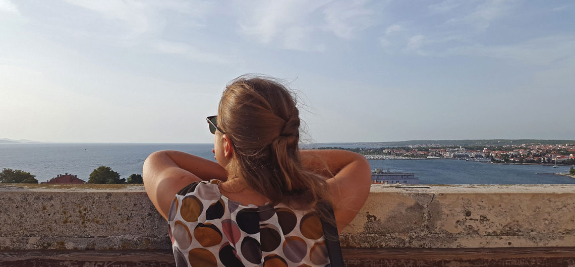 girl is standing at one of the must see places in Zadar