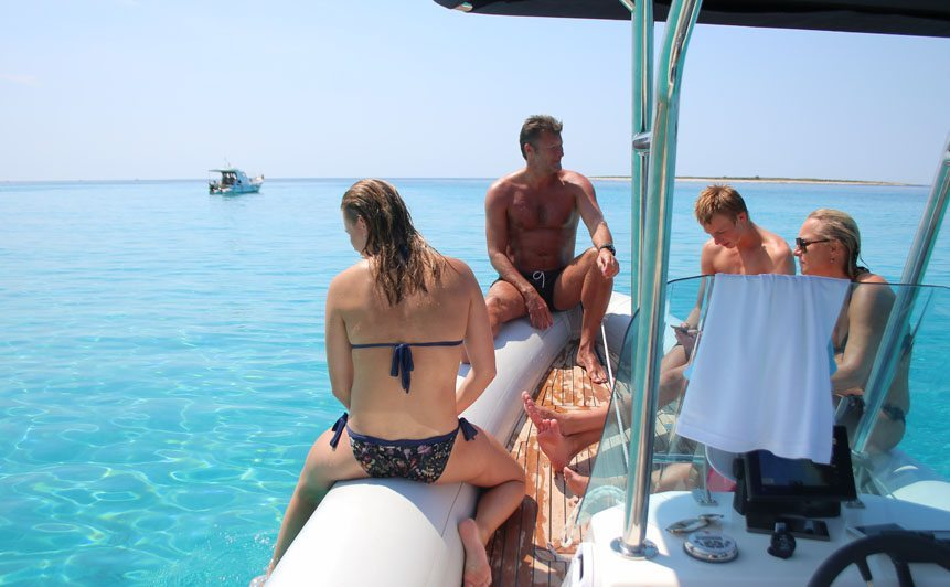 Sakarun Half-Day Beach Escape cover photo with tourists on a speed boat